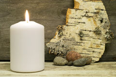 Candle, birch bark and stones Royalty Free Stock Image