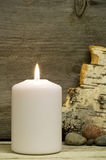 Candle, birch bark and stones Stock Photo