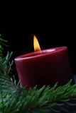 Candle and birch branch in the dark. Stock Photo
