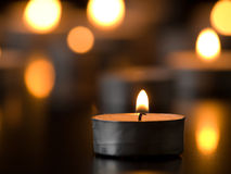 Candle on black Royalty Free Stock Image