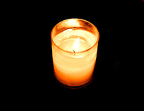 Candle on black bacground. Photo of candle on black bacground Stock Image
