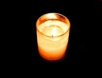 Candle on black bacground Stock Image