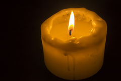 Candle. On a black background Royalty Free Stock Photos
