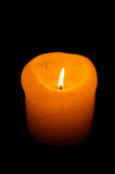 Candle on black background Stock Photography