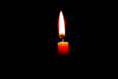 Candle on black background Stock Images