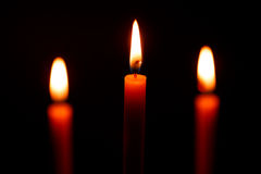 Candle on black background Royalty Free Stock Images