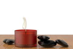 A candle and black stone heart on the floor. 3D illustration. Royalty Free Stock Photos