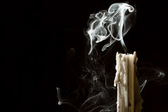 Candle blow off with smoke. On black background royalty free stock photo