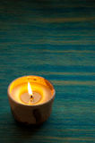Candle in blue Royalty Free Stock Photography