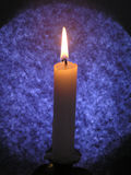 Candle on Blue. Blue backdrop for a traditional candle - seasonal royalty free stock photo