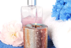 Candle with blue flowers. Royalty Free Stock Image