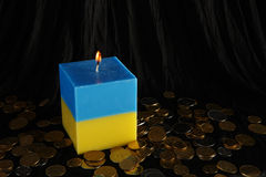Candle blue and yellow as a symbol of Ukraine Stock Photo