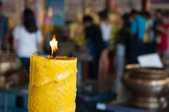 Candle on blur people to pray buddha Stock Photo