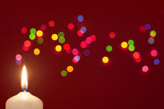 Candle with bokeh Stock Images