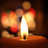 Candle. A candle with bokeh background Royalty Free Stock Photography