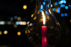 Candle bokeh. A candle burning in a hurricane candle holder Royalty Free Stock Photography