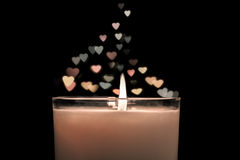 Candle with  bokeh hearts background rising soaring up. Vintage style. Candle with  bokeh hearts background rising soaring up. Vintage retro style Royalty Free Stock Image