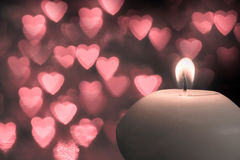 Candle with  bokeh red hearts shape Royalty Free Stock Images