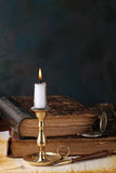 Candle with book Royalty Free Stock Images