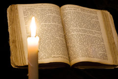 Candle and book Royalty Free Stock Images