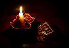 Candle and book. Stock Photos