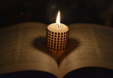 Candle and book. Reading bok with candle light Stock Photo