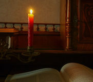 Candle and book Stock Image
