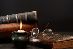 Candle And Books Stock Photo