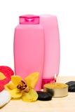 Candle, bottle of shampoo Royalty Free Stock Image
