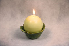 Candle in a bowl with soft light. Relax with some warm candlelight, this apple shaped candle gives off a soothing aroma stock photos