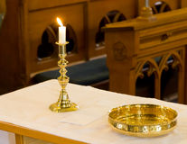 Candle and bowl. Taken at a church in south west england Stock Photos