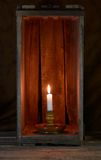 Candle in a box. A candle in a candle holder in a wooden box Stock Image