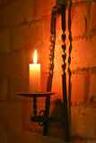 Candle in brass holder lighting Royalty Free Stock Photos