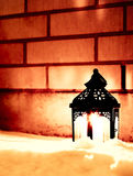 Candle and brick wall Royalty Free Stock Images