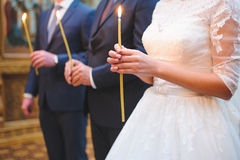 Candle in Bride's Hands Stock Image