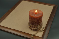 Candle. With a bright flame Stock Photos