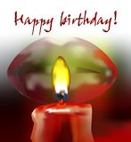 Candle burning and birthday wishes. Orange candle burning, sexy red lips and happy birthday wishes Royalty Free Stock Photo