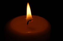 Candle. Burning with a black background Stock Image
