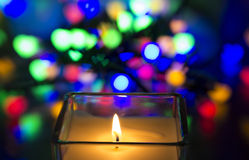 Candle burning with bokeh Royalty Free Stock Photos