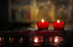 Candle burning in church - Vintage dirty look Royalty Free Stock Photo