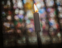 Candle burning in church - Vintage dirty look Stock Photo