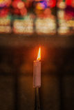 Candle burning in church - Vintage dirty look Royalty Free Stock Photos