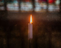 Candle burning in church - Vintage dirty look Stock Image
