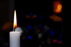 Candle burning in the dark Royalty Free Stock Photo