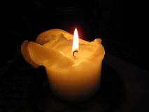 Candle burning in the dark Royalty Free Stock Image