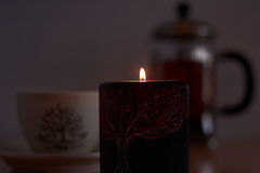 Candle burning in the dark. Royalty Free Stock Images