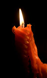 Candle burning in the darkness Royalty Free Stock Images
