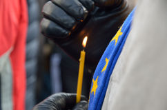 Candle burning in the male hands. Ukrainian hope Royalty Free Stock Photo