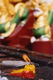 Candle burning in a pagoda. A votive candle burning in front of an altar at Shwedagon Pagoda in Yangon, Myanmar royalty free stock images