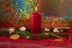 Candle. Burning red candle with fir branches Stock Images